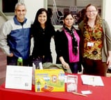 Children_Health_Fair_table_and_banner_with_staff_and_students