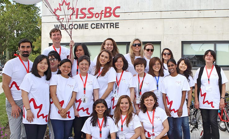 Staff in front of the ISSofBC Welcome Centre – a purpose-built facility providing essential settlement services.