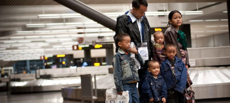 Government-Assisted Refugee family arrives at the airport in Canada.