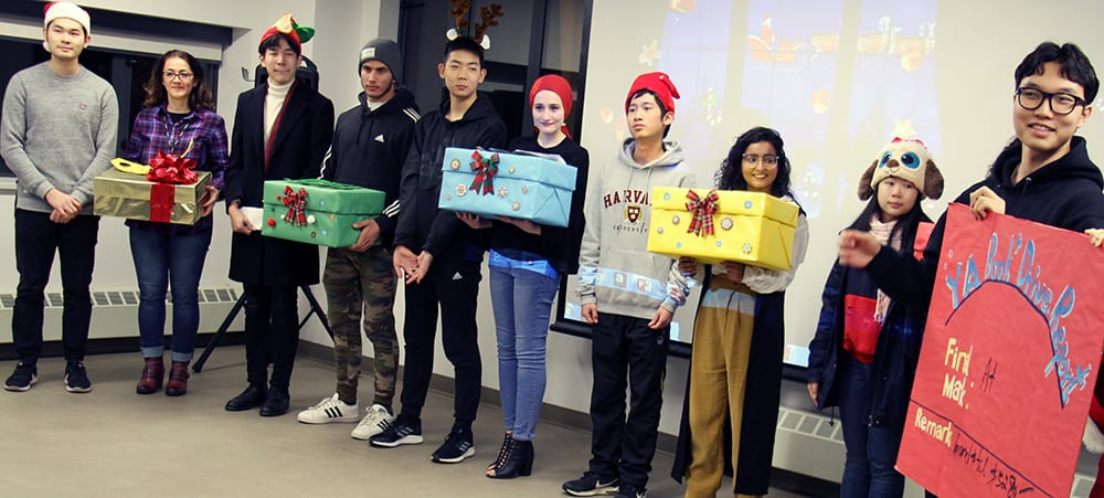 Vancouver high school students deliver over 1,200 items in book drive for refugee and immigrant youth at ISSofBC