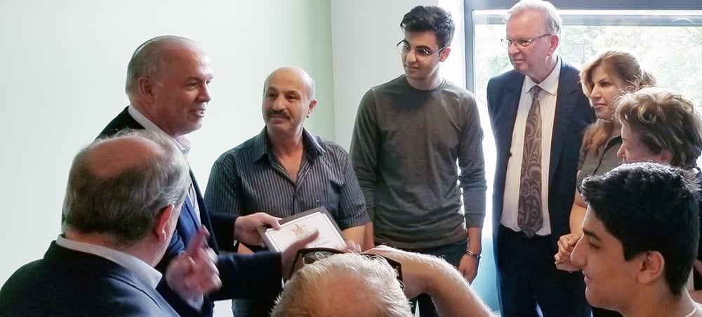 BC Premier John Horgan, Minister for Social Development and Poverty Reduction Shane Simpson and Minister of Jobs, Trade, and Technology Bruce Ralston welcomed two refugee families from Iran at ISSofBC Welcome Centre